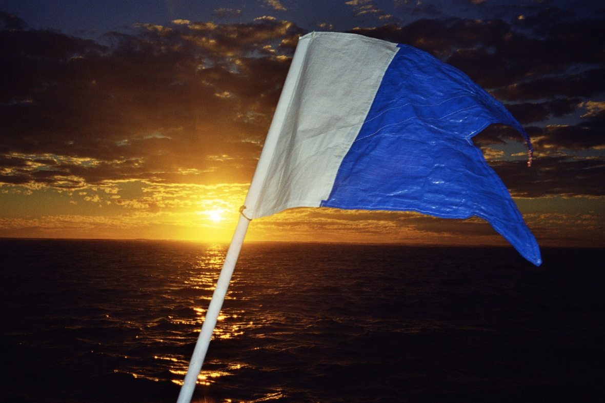 Dive flag at sunset, Coral Bay, Western Australia, Australia