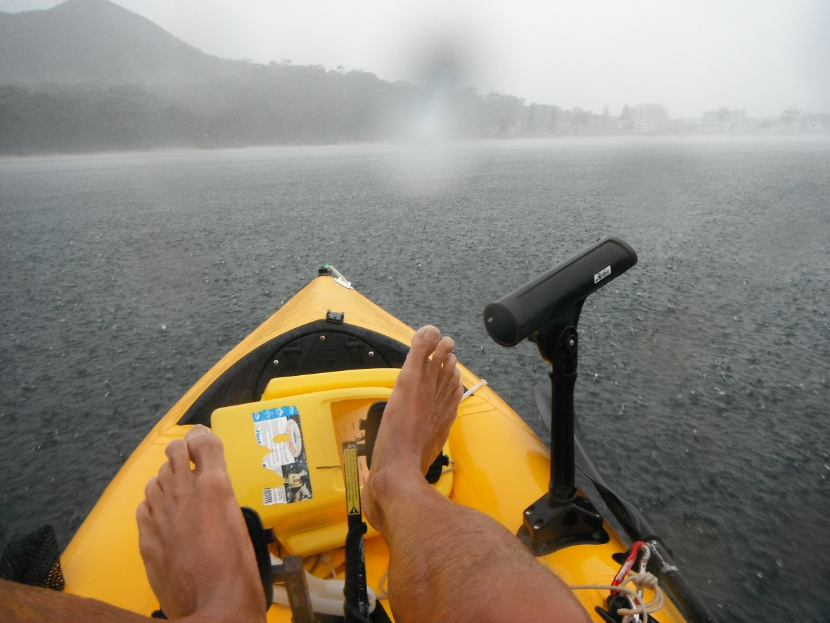 Paddling through a storm, Nelson Bay, New South Wales, Australia