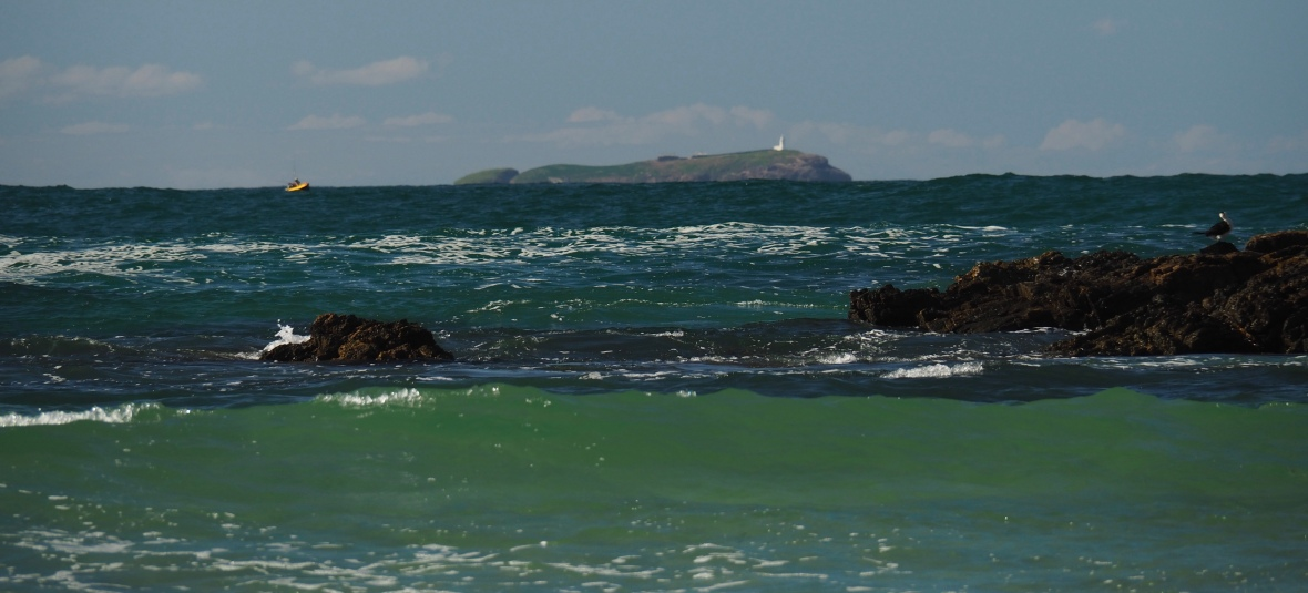 Made it through tricky swell, Solitary Island and lighthouse in the background of Diggers Beach, New South Wales, Australia