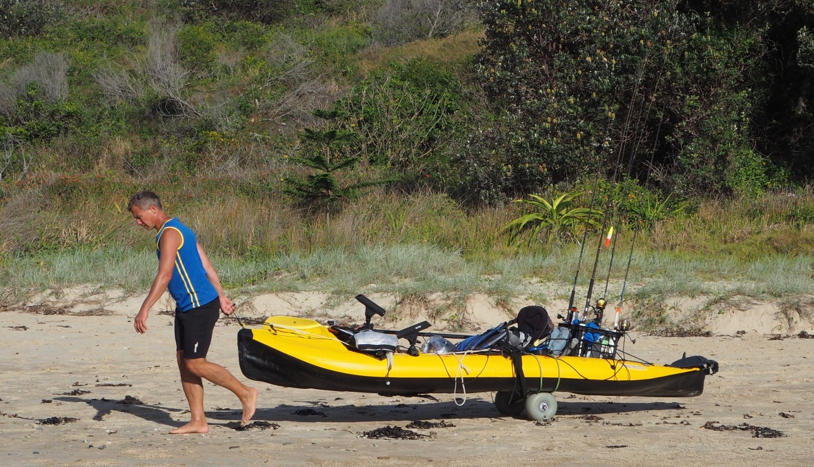 Kayak transport at Diggers Beach, New South Wales, Australia