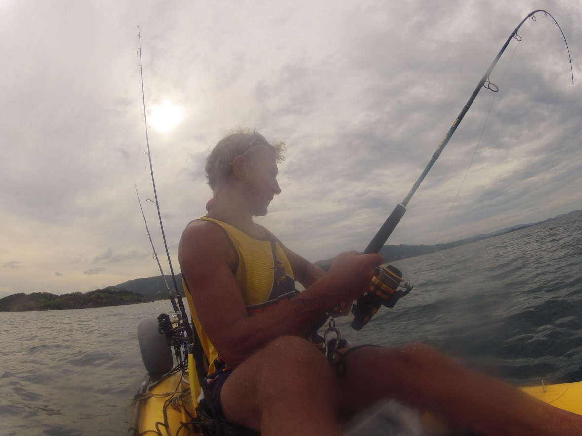 Handling a decent fish on the kayak is not easy, Coffs Harbour coastline, New South Wales, Australia