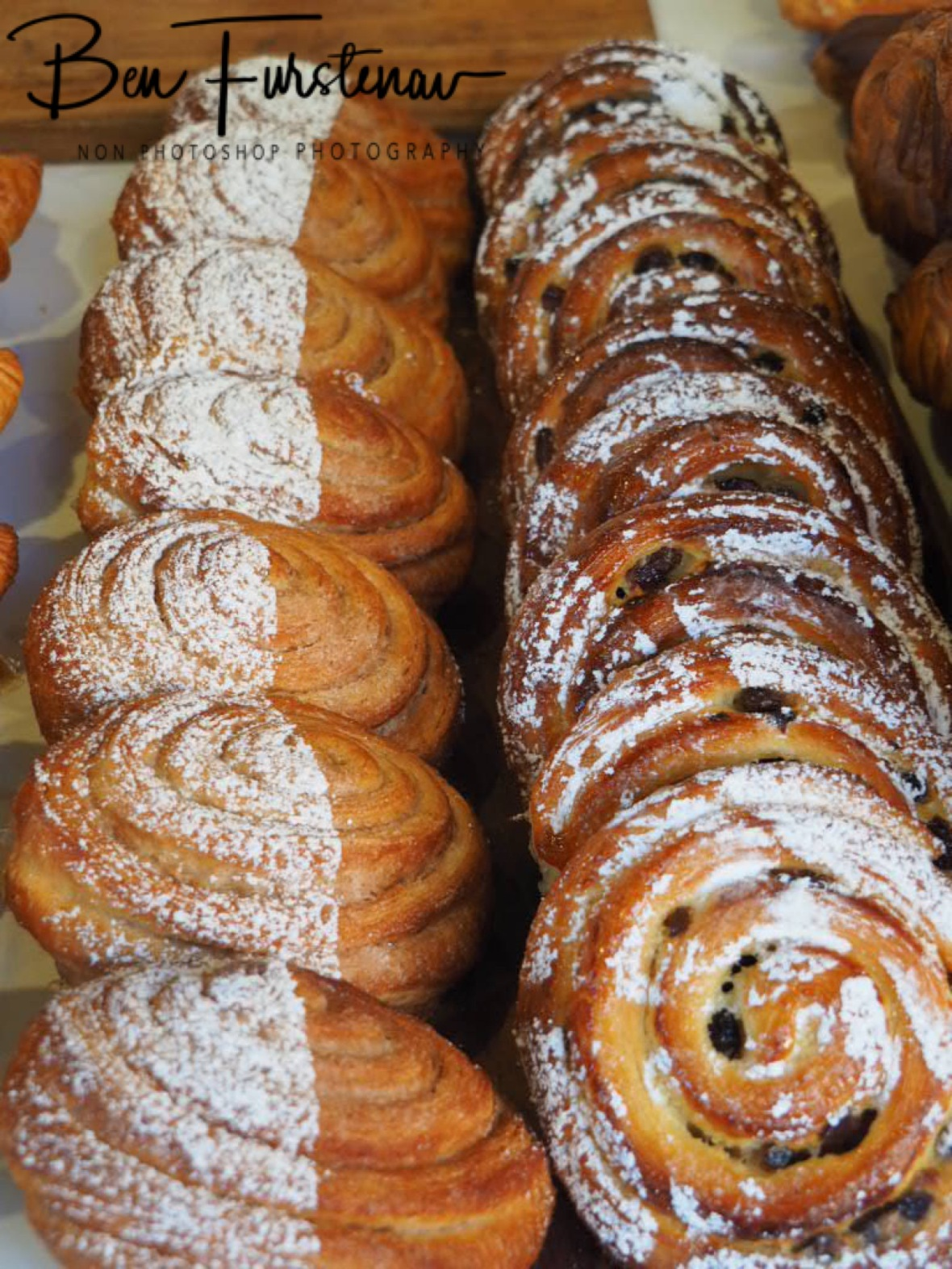 Cinnamon danish and pain aux raisins at display, Newrybar, New South Wales, Australia