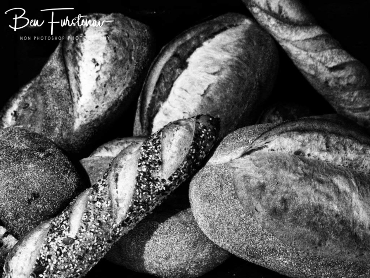 A basket of freshly baked sourdough bread selection, Newrybar, New South Wales, Australia
