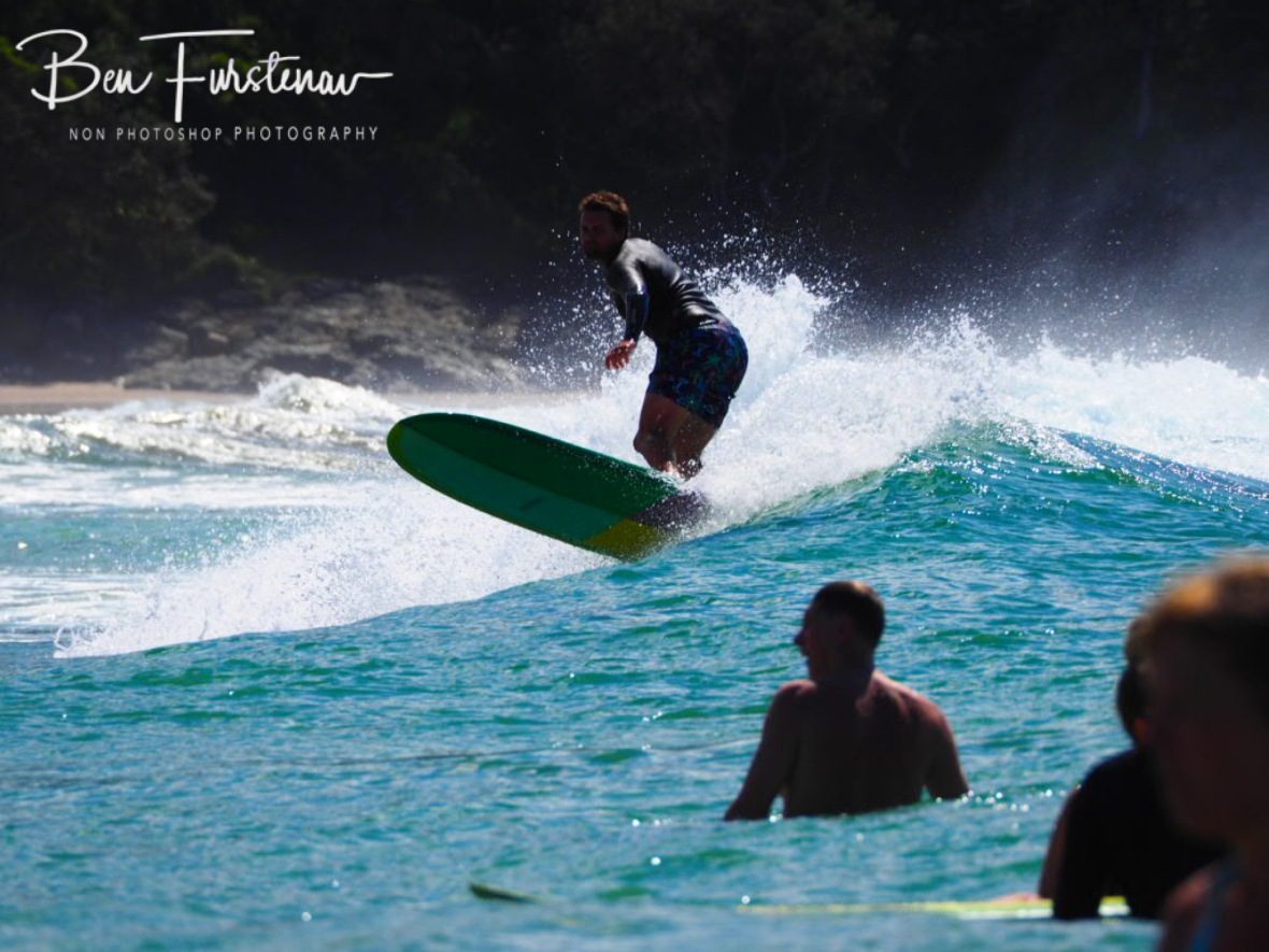 Crowded surf at Diggers Beach, New South Wales, Australia