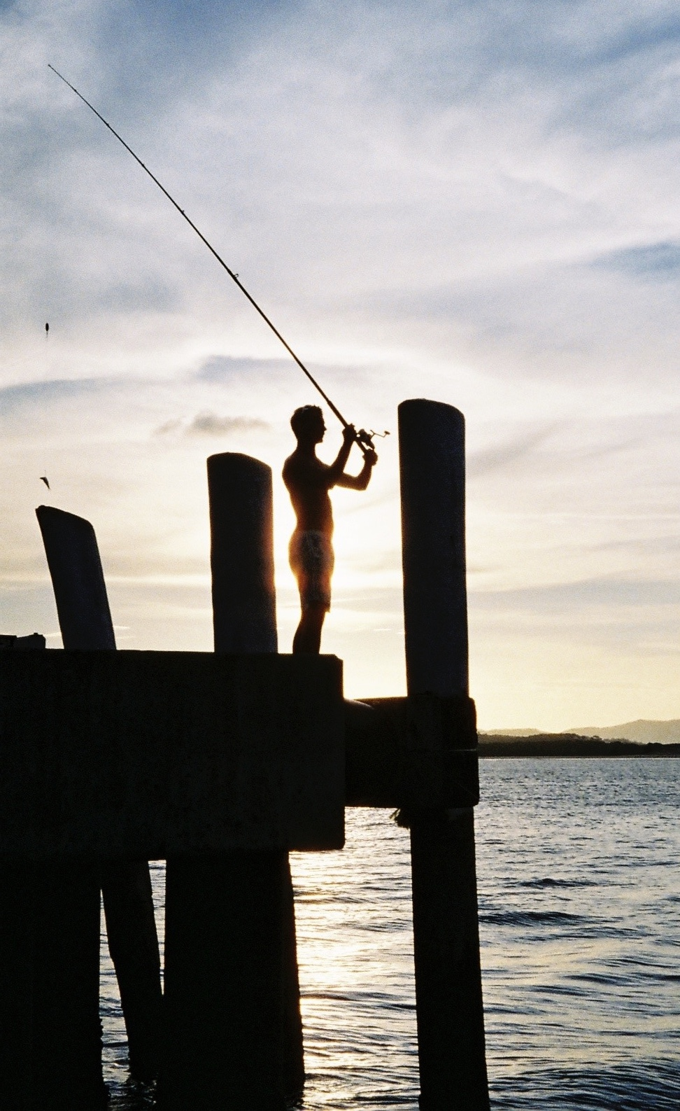 Fishing off Cooktown's jetty, Queensland, Australia