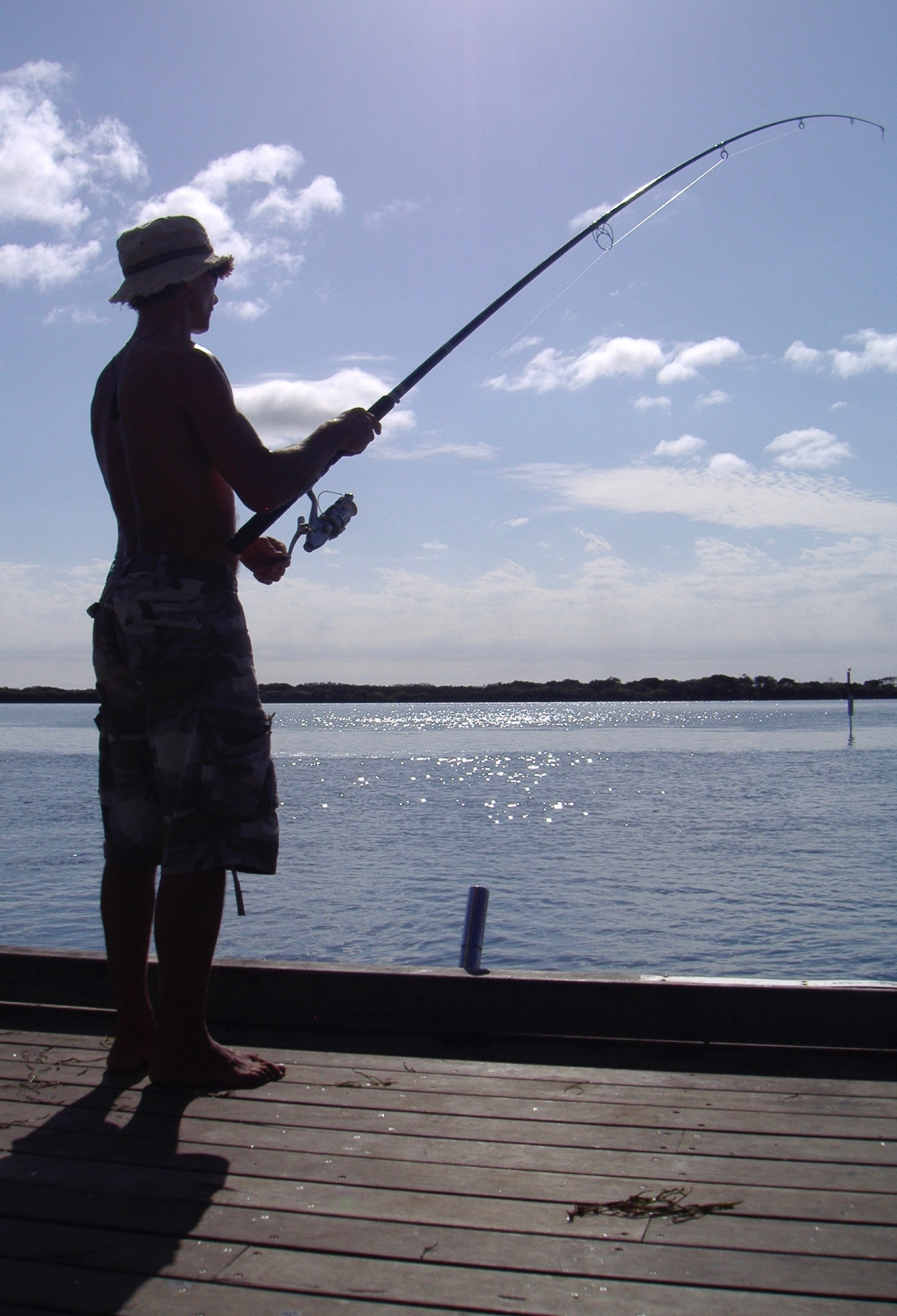 Fishing off the jetty in Caloundra, Queensland, Australia
