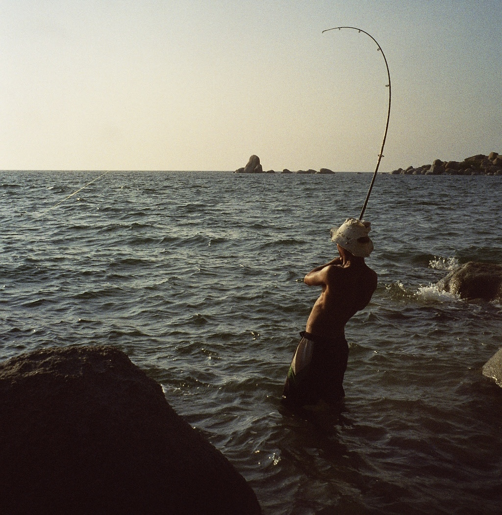 Hooked on a big one on remote Cape York Peninsula, Queensland, Australia