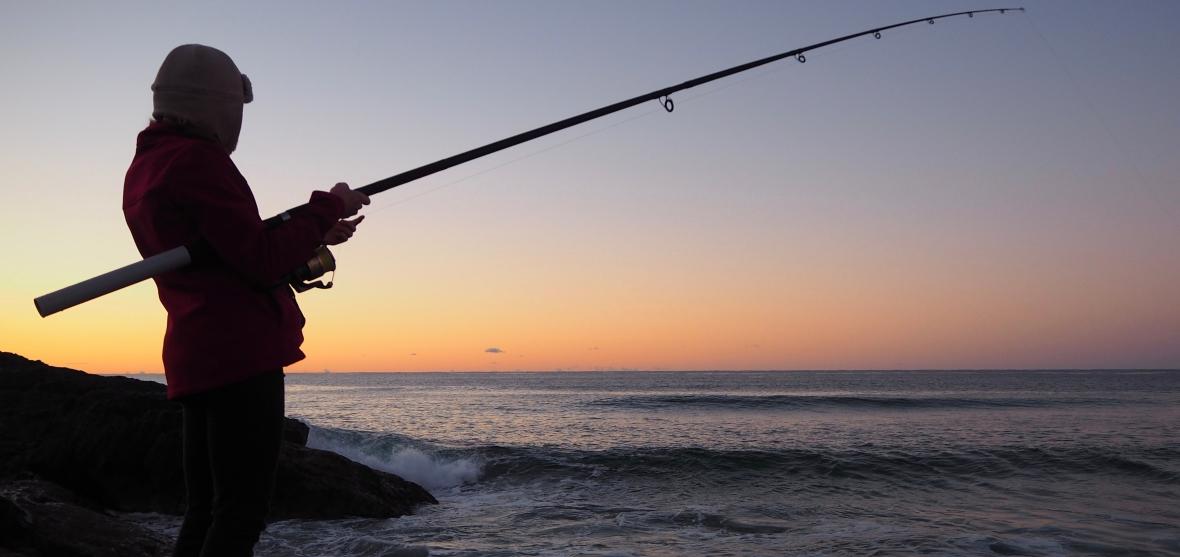 Early morning rock fishing of Sawtel Headland, New South Wales, Australia
