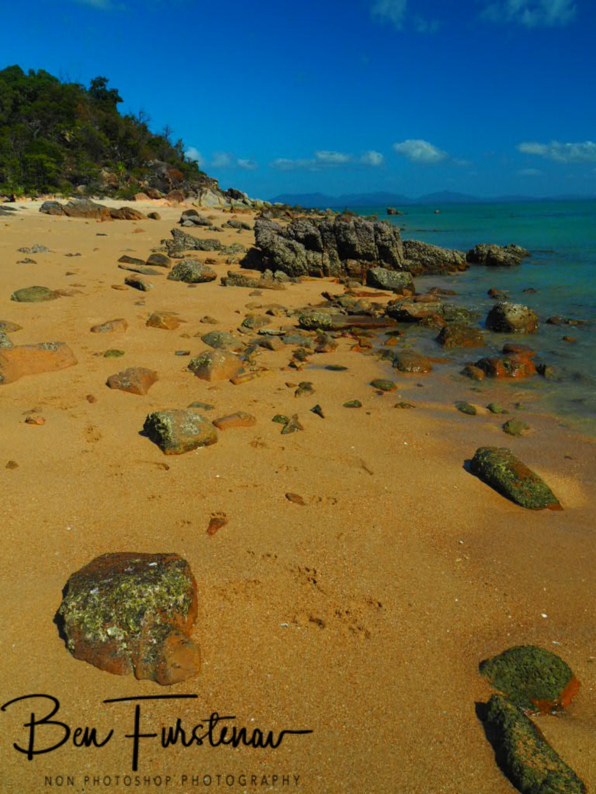 Red sand beaches overlooking Whitsunday Islands at Cape Gloucester, Queensland, Australia