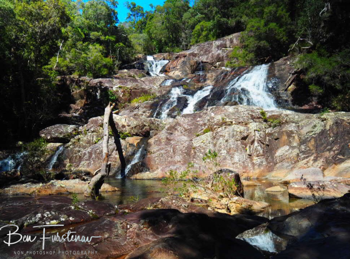 Waterfall reflections at Birthday Creek Falls, Northern Queensland, Australia