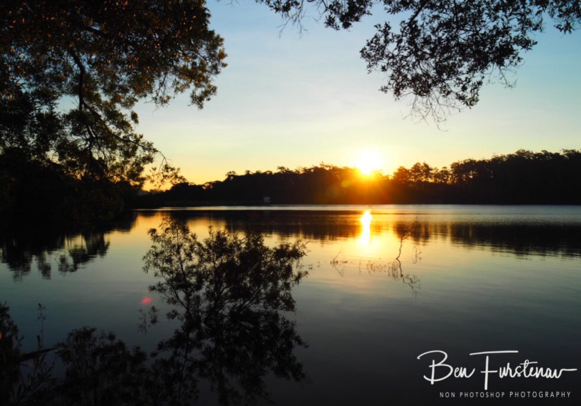 The sun's last warning  rays at Lake Paluma, Northern Queensland, Australia