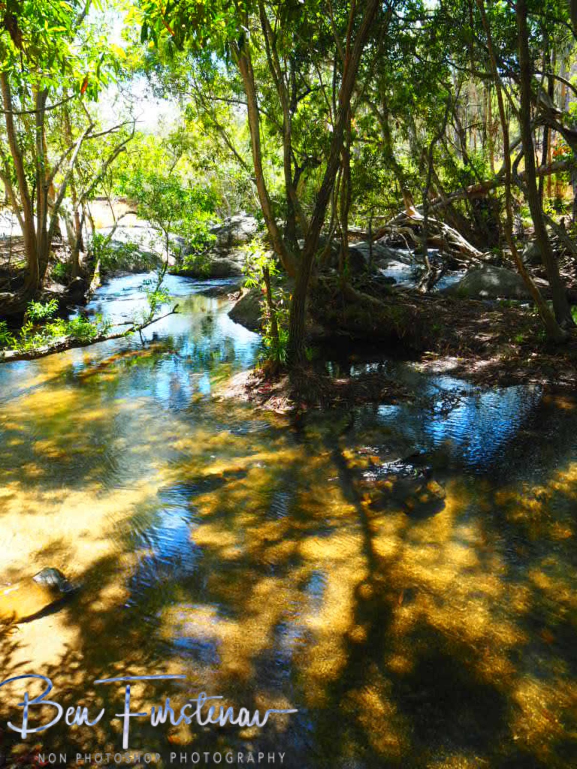 Shallow but cooling waters at Upper Davies Creek, Atherton Tablelands, Far North Queensland, Australia